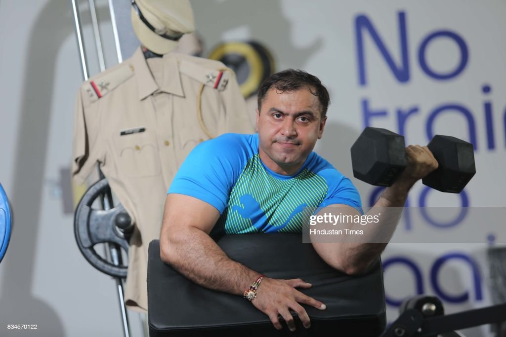 Rajbir Singh Siwach, Assistant Sub-Inspector (ASI) of Gurugram Police, poses during an exclusive interview with Hindustan Times, on August 10, 2017 in Gurugram, India. Rajbir Singh Siwach, from Faridabad, recently won two gold medals in powerlifting and speaks on how he manages to stay fit despite his 24X7 job. He says, 'I can't live without gymming!' The fitness-freak has recently won two gold medals for Bench Press (140 kg) at Bodysterone National Body Building Association's Mr North India, in two categories - Newcomers and Masters. Hailing from Faridabad, the 37-year-old officer, with his 18.1 inch biceps and chiselled body, encourages his colleagues (policemen) to follow his footsteps.