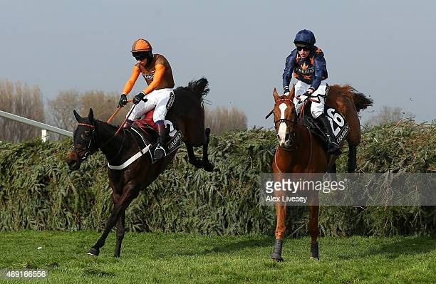 Rajdhani Express ridden by Sam WaleyCohen jumps the last fence alongside Fairy Rath ridden by Tom Cannon on their way to victory in the Crabbie's...