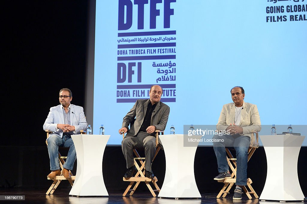 Rajeev Masand Actor Anupam Kher jury member Ashutosh Gowariker speak at the Going Global Can Bollywood Films Crossover Panel during the 2012 Doha...