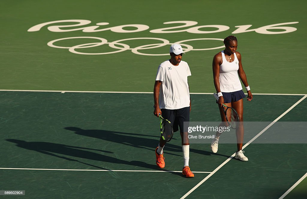 Rajeev Ram and Venus Williams of the United States look dejected following the mixed doubles gold medal match against Jack Sock of the United States...