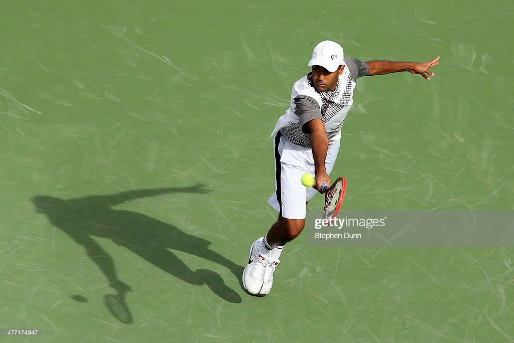 Rajeev Ram hits a return to Horacio Ceballos of Argentina during the BNP Paribas Open at Indian Wells Tennis Garden on March 7 2014 in Indian Wells...