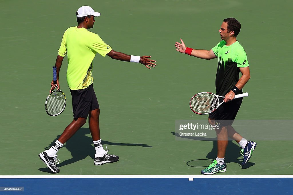 <a gi-track='captionPersonalityLinkClicked' href=/galleries/search?phrase=Rajeev+Ram&family=editorial&specificpeople=2089360 ng-click='$event.stopPropagation()'>Rajeev Ram</a> (L) of the United States and <a gi-track='captionPersonalityLinkClicked' href=/galleries/search?phrase=Scott+Lipsky&family=editorial&specificpeople=4158560 ng-click='$event.stopPropagation()'>Scott Lipsky</a> (R) of the United States reacts during a quarterfinal men's doubles match against Eric Butorac of the United States and Raven Klaasen of South Africa on Day Nine of the 2014 US Open at the USTA Billie Jean King National Tennis Center on September 2, 2014 in the Flushing neighborhood of the Queens borough of New York City.