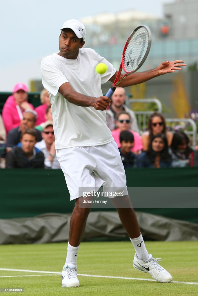 Rajeev Ram of the United States of America plays a backhand during his Gentlemen's Singles second round match against Juan Monaco of Argentina on day...