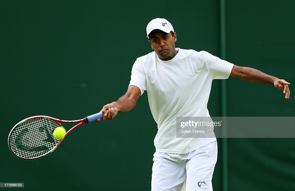 Rajeev Ram of the United States of America plays a forehand during his Gentlemen's Singles second round match against Juan Monaco of Argentina on day...
