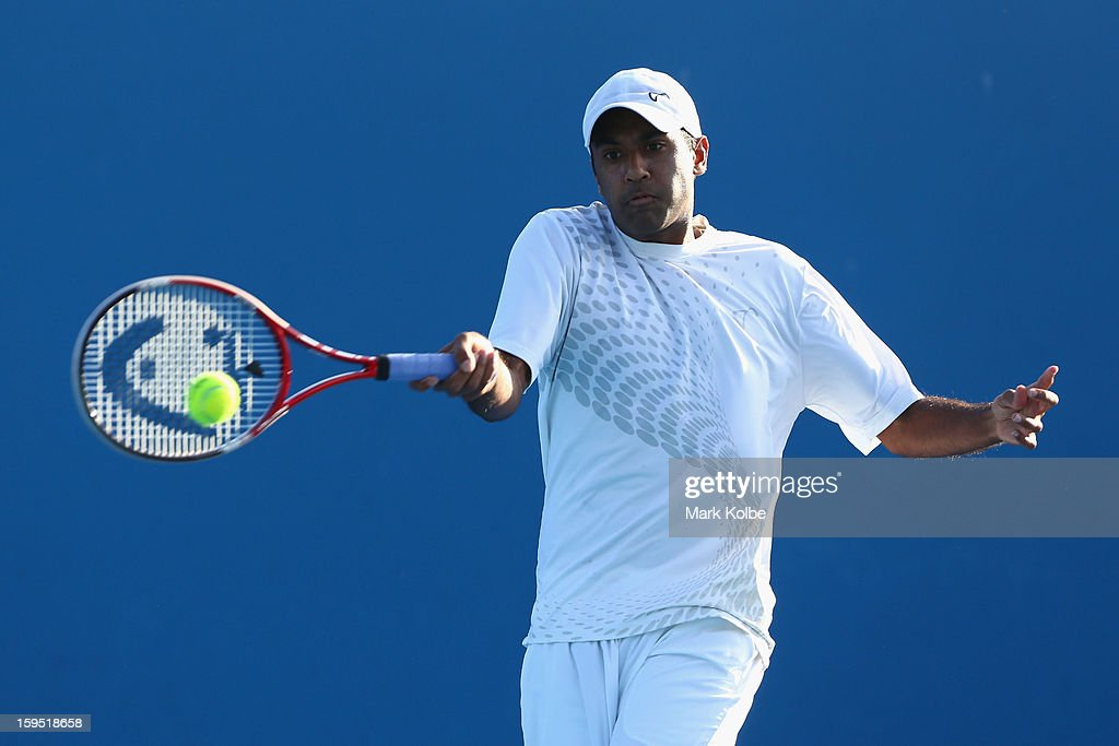 Rajeev Ram of the United States of America plays a forehand in his first round match against Guillermo Garcia-Lopez of Spain during day two of the 2013 Australian Open at Melbourne Park on January 15, 2013 in Melbourne, Australia.