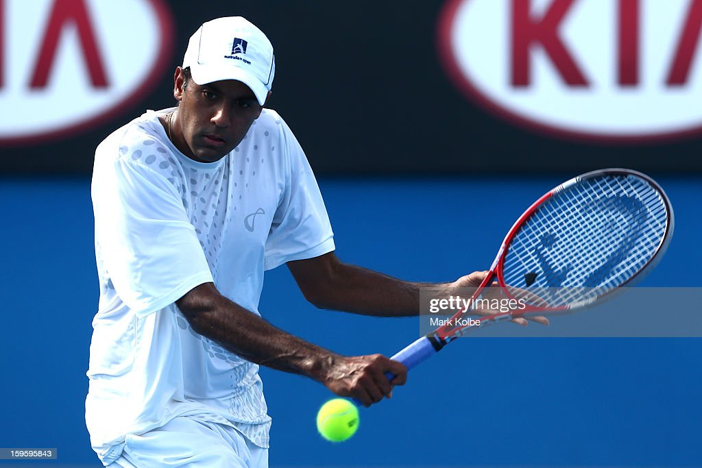 Rajeev Ram of the United States plays a backhand in his second round match against Marin Cilic of Croatia during day four of the 2013 Australian Open at Melbourne Park on January 17, 2013 in Melbourne, Australia.