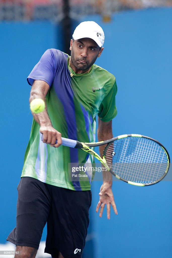 Rajeev Ram of the United States plays a backhand in his second round match against Stephane Robert of France during day four of the 2016 Australian...