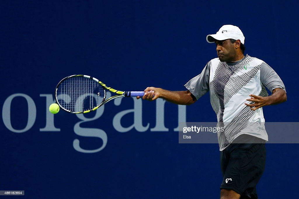 Rajeev Ram of the United States returns a shot against Ryan Harrison of the United States during their Men's Singles First Round match on Day Two of...
