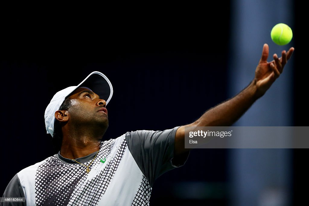 Rajeev Ram of the United States serves against Ryan Harrison of the United States during their Men's Singles First Round match on Day Two of the 2015...