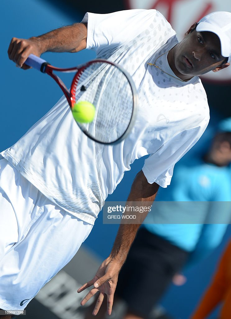 Rajeev Ram of the US plays a return during his men's singles match against Croatia's Marin Cilic on the fourth day of the Australian Open tennis tournament in Melbourne on January 17, 2013. AFP PHOTO/GREG WOOD IMAGE STRICTLY RESTRICTED TO EDITORIAL USE - STRICTLY NO COMMERCIAL USE