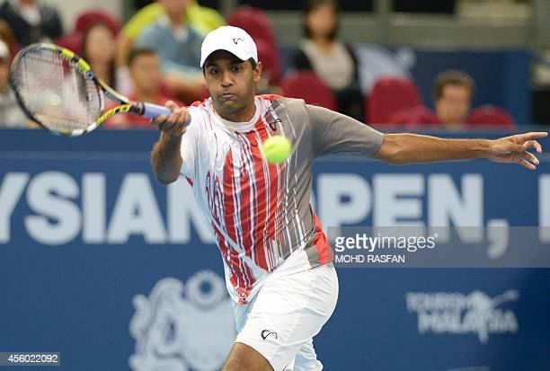 Rajeev Ram of the US returns a shot against Kei Nishikori of Japan in the men's singles second round at the ATP Malaysia Open tennis tournament in...