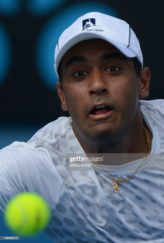 Rajeev Ram of the US watches the ball as he plays a return during his men's singles match against Croatia's Marin Cilic on the fourth day of the Australian Open tennis tournament in Melbourne on January 17, 2013.
