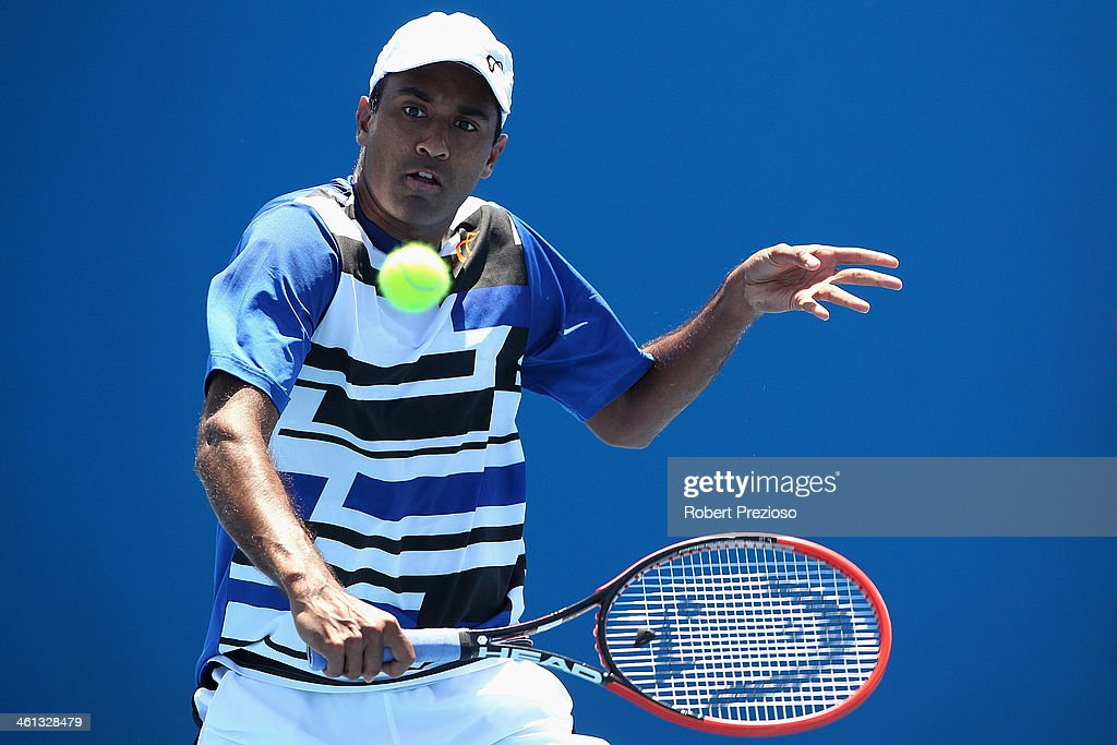 Rajeev Ram of United States plays a backhand in his match against Marco Cecchinato of Italy during qualifying for the 2014 Australian Open at...
