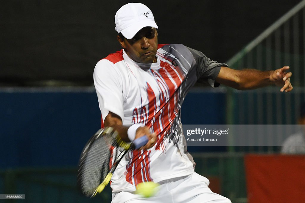 <a gi-track='captionPersonalityLinkClicked' href=/galleries/search?phrase=Rajeev+Ram&family=editorial&specificpeople=2089360 ng-click='$event.stopPropagation()'>Rajeev Ram</a> of USA in action during the men's singles first round match against Jeremy Chardy of France on day two of Rakuten Open 2014 at Ariake Colosseum on September 30, 2014 in Tokyo, Japan.