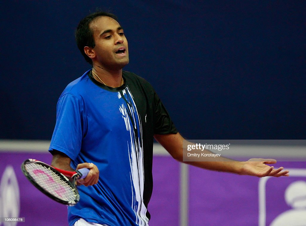 <a gi-track='captionPersonalityLinkClicked' href=/galleries/search?phrase=Rajeev+Ram&family=editorial&specificpeople=2089360 ng-click='$event.stopPropagation()'>Rajeev Ram</a> of USA reacts during day three of the International Tennis Tournament St Petersburg Open 2010 match against Pablo Andujar of Spain at the Sports Complex Petersburgsky on October 26, 2010 in St Petersburg, Russia.