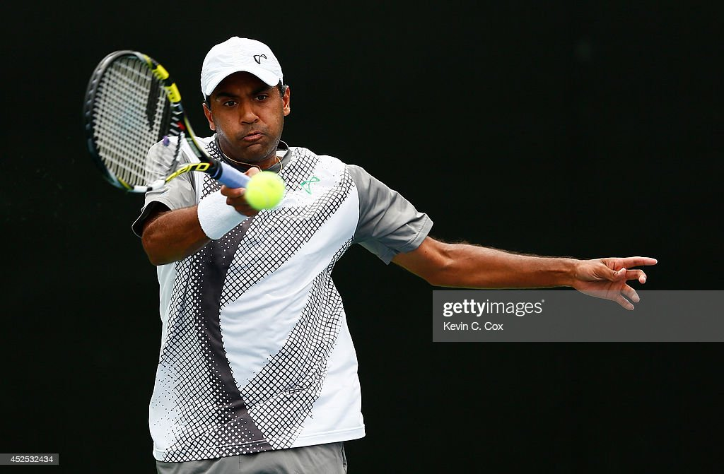 Rajeev Ram returns a forehand to Denis Istomin of Uzbekistan during the BB&T Atlanta Open at Atlantic Station on July 22, 2014 in Atlanta, Georgia.