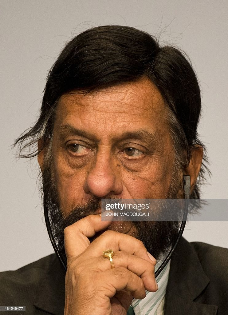 <a gi-track='captionPersonalityLinkClicked' href=/galleries/search?phrase=Rajendra+Pachauri&family=editorial&specificpeople=4128691 ng-click='$event.stopPropagation()'>Rajendra Pachauri</a>, Chairman of the Intergovernmental Panel on Climate Change (IPCC) listens through a headset during a press conference following the release of the IPCC report 'Climate Change 2014, Mitigation of Climate Change' in Berlin on April 13, 2014. The world has a likely chance of meeting the UN's warming limit of two degrees Celsius (3.6 degrees Fahrenheit) if it cuts annual greenhouse gas emissions 40-70 percent by 2050, especially from energy, a top expert panel said Sunday, April 13, 2014. MACDOUGALL