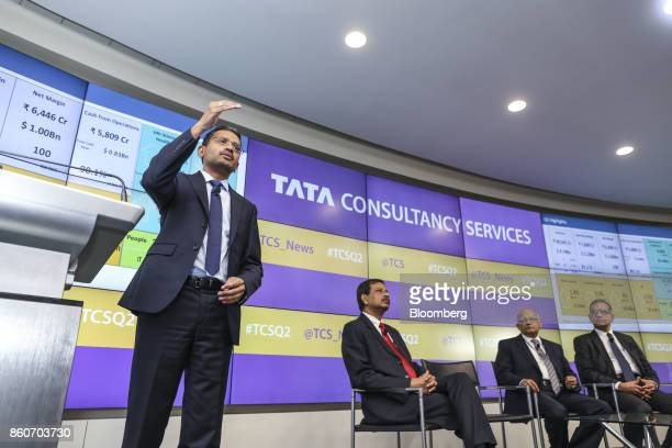 Rajesh Gopinathan chief executive officer and managing director of Tata Consultancy Services Ltd from left speaks while Ajoy Mukharjee executive vice...