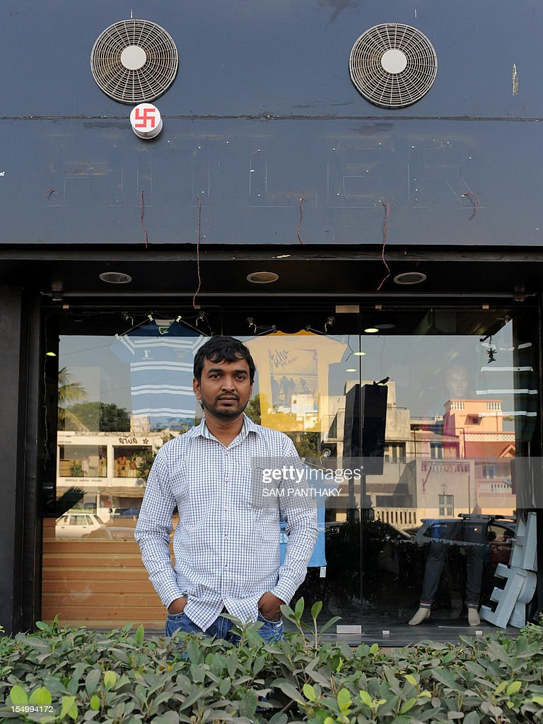 Rajesh Shah, One of the two Indian owners of the Hitler clothing store, poses in front of his shop in Ahmedabad on October 30, 2012. The owner of an Indian clothing store said October 30 that the Ahmedabad Municipal Corporation (AMC) officials came and removed the words 'Hitler' from the shop's signboard. The minority Jewish community in Ahmedabad objected to the name of the clothing shop, which opened its doors on August 19, 2012. AFP PHOTO / Sam PANTHAKY