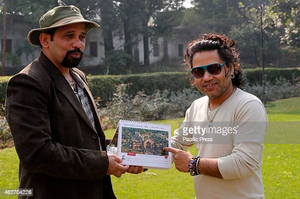 Rajesh Singh offers calendar to the singer Kailash Kher during his visit at Lucknow