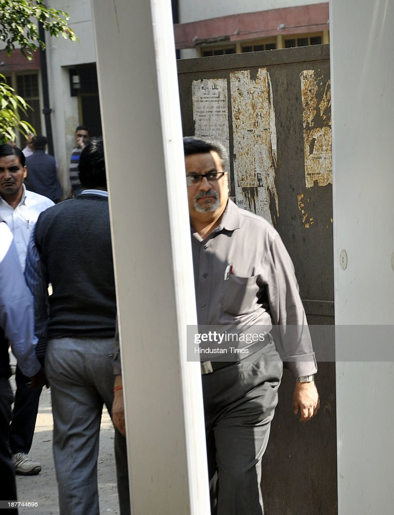 Rajesh Talwar accused in Aarushi-Hemraj double murder case at CBI Court on November 11, 2013 in Ghaziabad, India. The lawyer representing the Talwars, the parents accused in the murder of the 14-year-old Aarushi in Noida in 2008, argued in the CBI court on Monday that the probe agency manipulated evidence it provided in court.