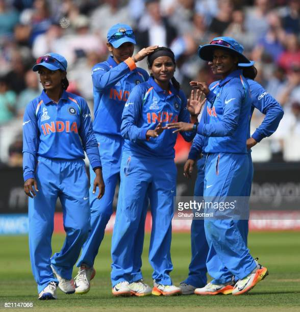 Rajeshwari Gayakwad is congratulated by teammates after taking a wicket during the ICC Women's World Cup 2017 Final between England and India at...
