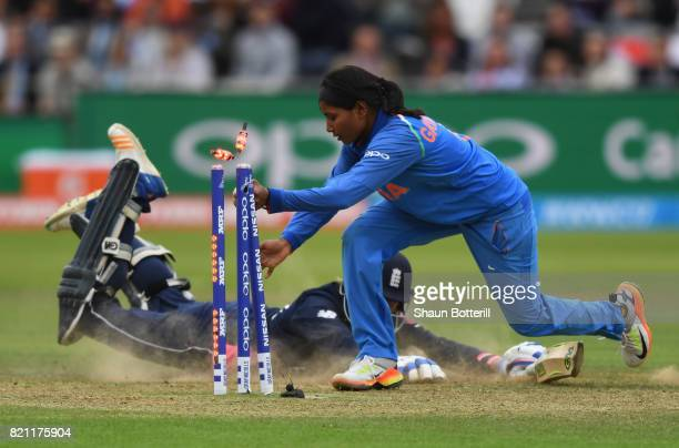 Rajeshwari Gayakwad of India attempts to run out Jenny Gunn of England during the ICC Women's World Cup 2017 Final between England and India at...