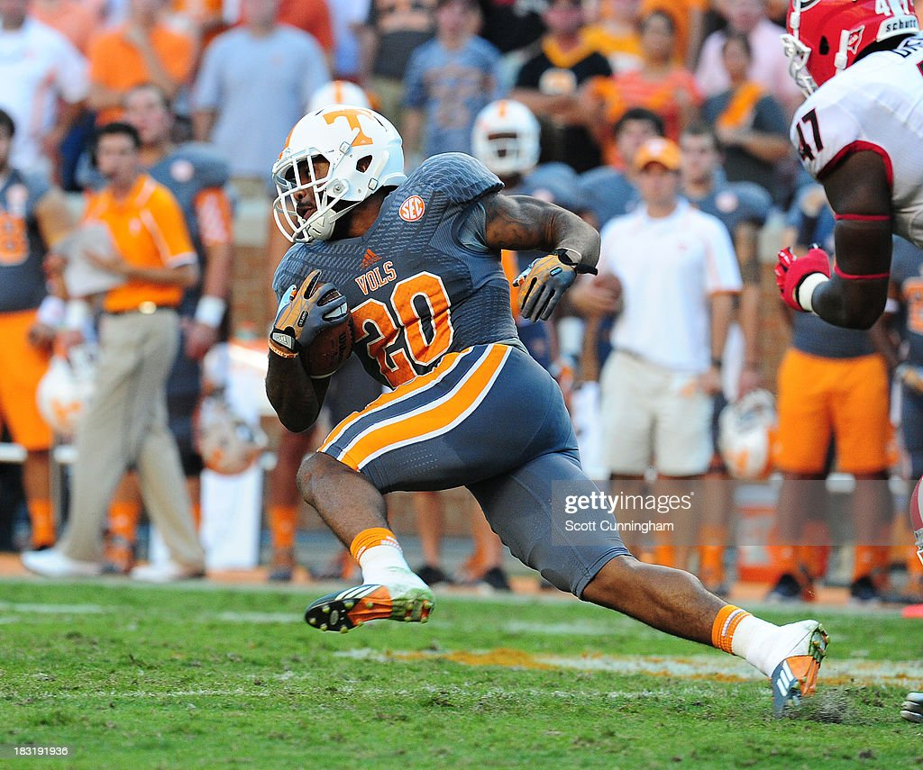 Rajion Neal #20 of the Tennessee Volunteers carries the ball against the Georgia Bulldogs at Neyland Stadium on October 5, 2013 in Knoxville, Tennessee.