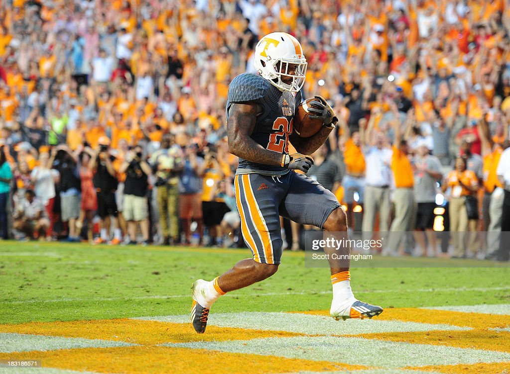 Rajion Neal #20 of the Tennessee Volunteers carries the ball for a 2nd half touchdown against the Georgia Bulldogs at Neyland Stadium on October 5, 2013 in Knoxville, Tennessee.