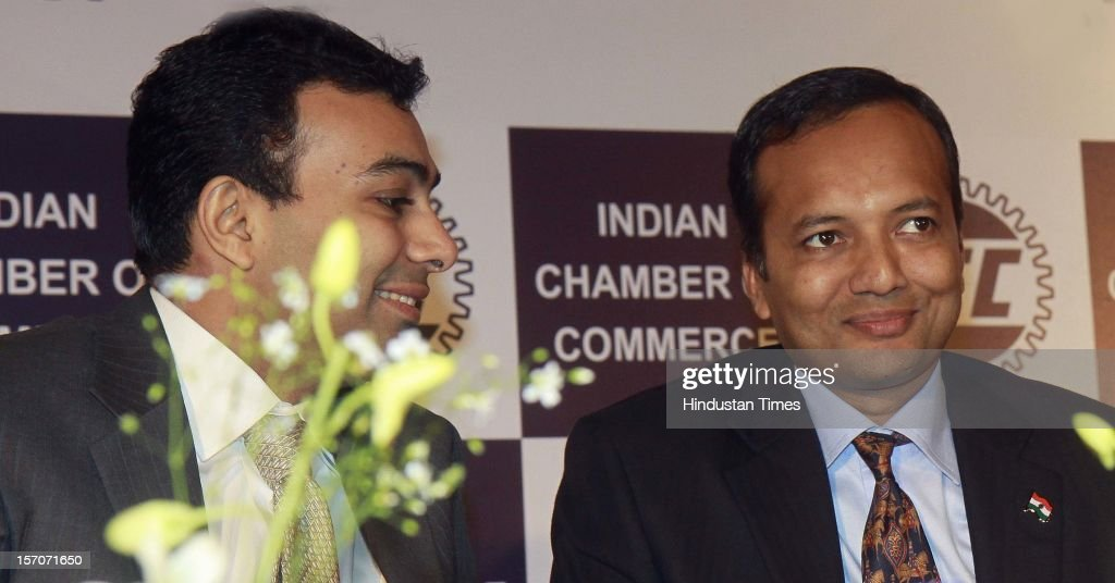 Rajiv Mundhar President Indian Chamber of commerce, (L) talking with Naveen Jindal Chairman and managing Director Jindal Steel and Power Ltd. and member of parliament (R) attending the inaugural session of Indian coal Industry outlook till 2030 on November 28, 2012 in New Delhi, India.