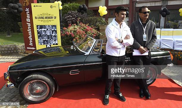 Rajiv Pratap Rudy Union Minister of State for Skill Development with Armaan Ebrahim car racer poses during a Car Rally for Parliamentarians organised...