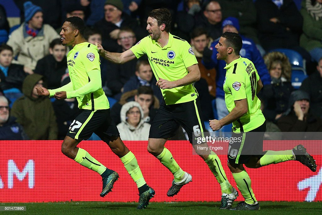 Rajiv van La Parra of Brighton (L) celebrates scoring his team's second goal during the Sky Bet Championship match between Queens Park Rangers and Brighton and Hove Albion at Loftus Road on December 15, 2015 in London, United Kingdom.