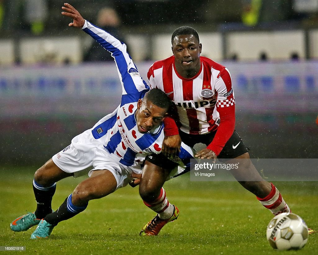 Rajiv van la Parra of Heerenveen (L), Jurgen Locadia (R) during the Dutch Eredivisie match between SC Heerenveen and PSV Eindhoven at the Abe Lenstra Stadium on march 09, 2013 in Heerenveen, The Netherlands