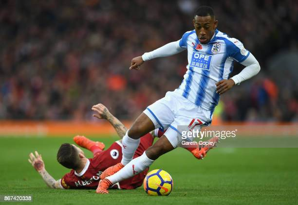 Rajiv van La Parra of Huddersfield Town and Alberto Moreno of Liverpool battle for possession during the Premier League match between Liverpool and...