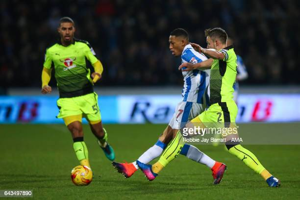 Rajiv Van La Parra of Huddersfield Town and Chris Gunter of Reading during the Sky Bet Championship match between Huddersfield Town and Reading at...