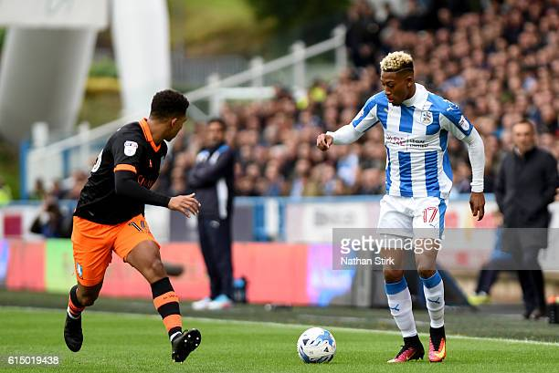 Rajiv van La Parra of Huddersfield Town and Liam Palmer of Sheffield Wednesday in action during the Sky Bet Championship match between Huddersfield...