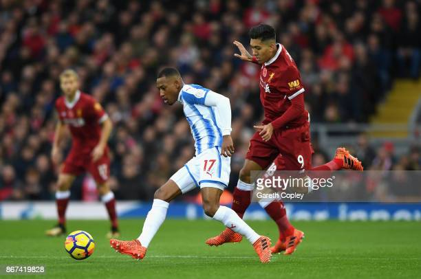 Rajiv van La Parra of Huddersfield Town and Roberto Firmino of Liverpool battle for possession during the Premier League match between Liverpool and...