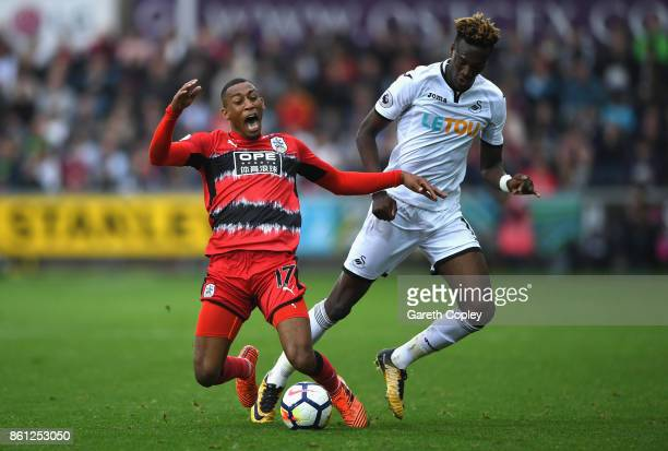 Rajiv van La Parra of Huddersfield Town and Tammy Abraham of Swansea City battle for possession during the Premier League match between Swansea City...