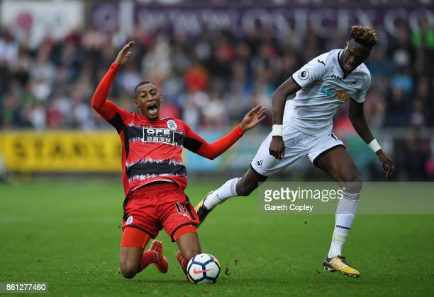 Rajiv van La Parra of Huddersfield Town and Tammy Abraham of Swansea City compete for the ball during the Premier League match between Swansea City...