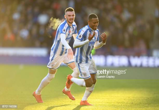 Rajiv van La Parra of Huddersfield Town celebrates with team mates after scoring his sides first goal during the Premier League match between...