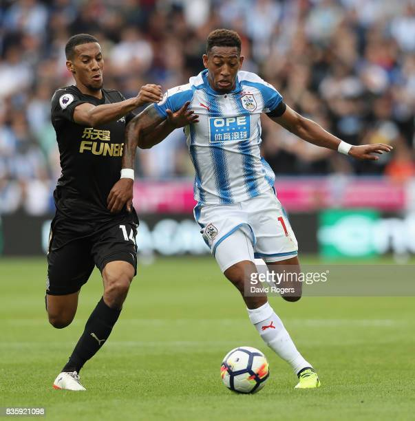 Rajiv van la Parra of Huddersfield Town is tackled by Isaac Hayden during the Premier League match between Huddersfield Town and Newcastle United at...