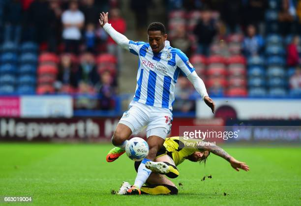Rajiv Van La Parra of Huddersfield Town is tackled by John Brayford of Burton Albion during the Sky Bet Championship match between Huddersfield Town...