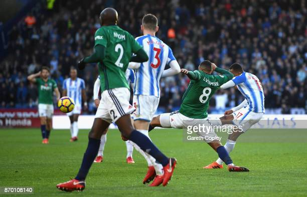 Rajiv van La Parra of Huddersfield Town scores his sides first goal during the Premier League match between Huddersfield Town and West Bromwich...