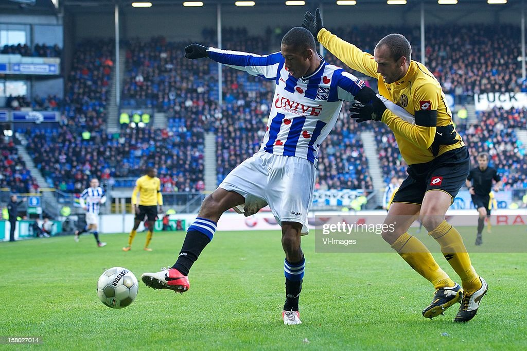 Rajiv van La Parra of SC Heerenveen, Jimmy Hempte of Roda JC Kerkrade during the Dutch Eredivisie match between SC Heerenveen and Roda JC Kerkrade at the Abe Lenstra Stadium on December 09, 2012 in Heerenveen, The Netherlands.