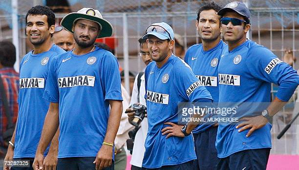 India cricketers Zaheer Khan Harbhajan Singh Ajit Agarkar Irfan Pathan and Anil Kumble watch teammates during a training session at the Madhavrao...