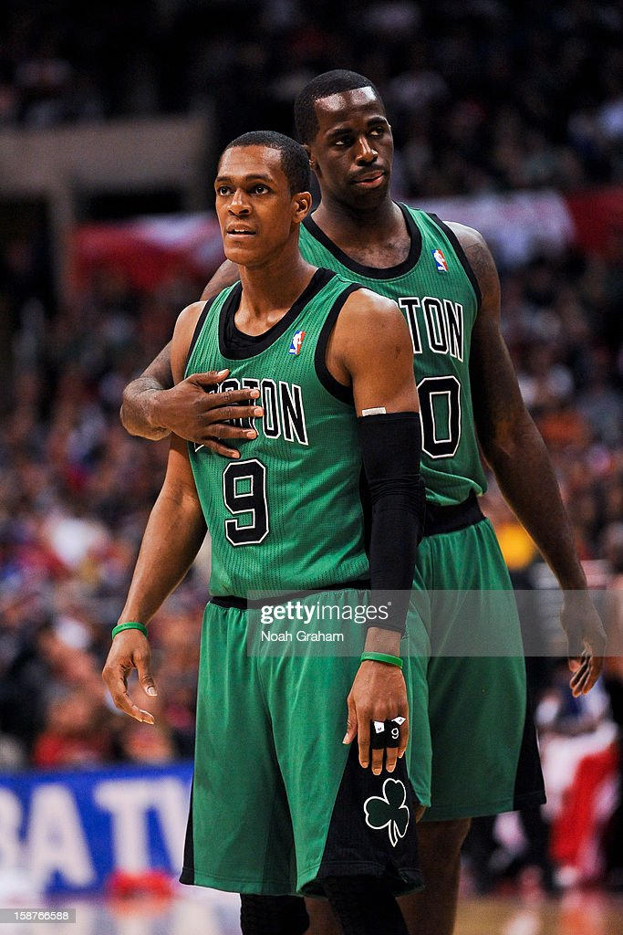 Rajon Rondo #9 and Brandon Bass #30 of the Boston Celtics wait to resume action against the Los Angeles Clippers on December 27, 2012 at the Staples Center in Los Angeles, California.
