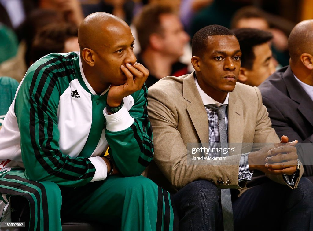 <a gi-track='captionPersonalityLinkClicked' href=/galleries/search?phrase=Rajon+Rondo&family=editorial&specificpeople=206983 ng-click='$event.stopPropagation()'>Rajon Rondo</a> #9 and <a gi-track='captionPersonalityLinkClicked' href=/galleries/search?phrase=Keith+Bogans&family=editorial&specificpeople=202483 ng-click='$event.stopPropagation()'>Keith Bogans</a> #4 of the Boston Celtics sit on the bench in the second half against the Milwaukee Bucks during the home opener at TD Garden on November 1, 2013 in Boston, Massachusetts.