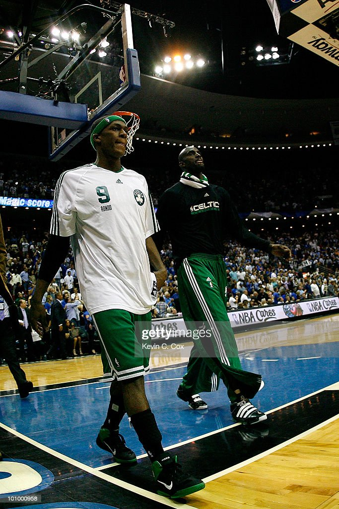 Rajon Rondo #9 and Keivn Garnett #5 of the Boston Celtics walks off the court dejected after they lost 113-92 against the Orlando Magic in Game Five of the Eastern Conference Finals during the 2010 NBA Playoffs at Amway Arena on May 26, 2010 in Orlando, Florida.