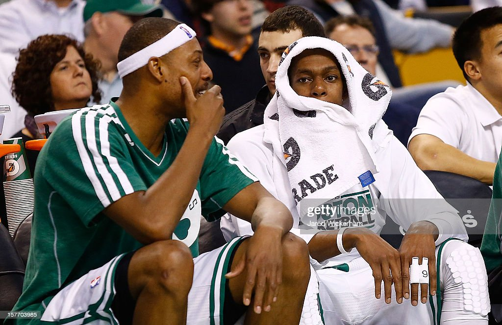 Rajon Rondo #9 and Paul Pierce #34 of the Boston Celtics talk on the bench against the Minnesota Timberwolves during the game on December 5, 2012 at TD Garden in Boston, Massachusetts.