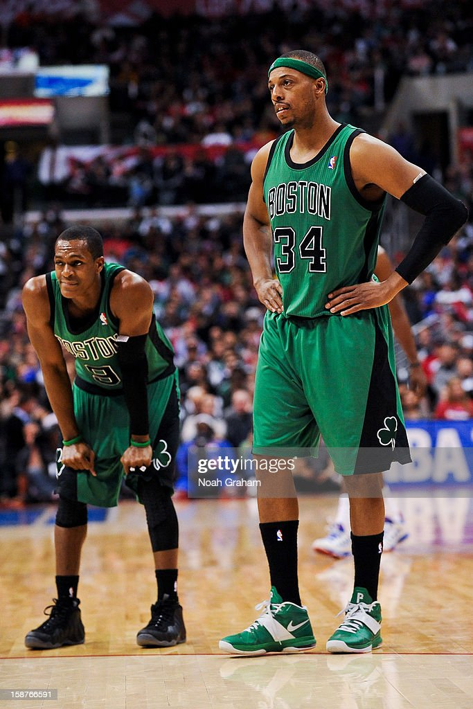 Rajon Rondo #9 and Paul Pierce #34 of the Boston Celtics wait to resume action against the Los Angeles Clippers on December 27, 2012 at the Staples Center in Los Angeles, California.